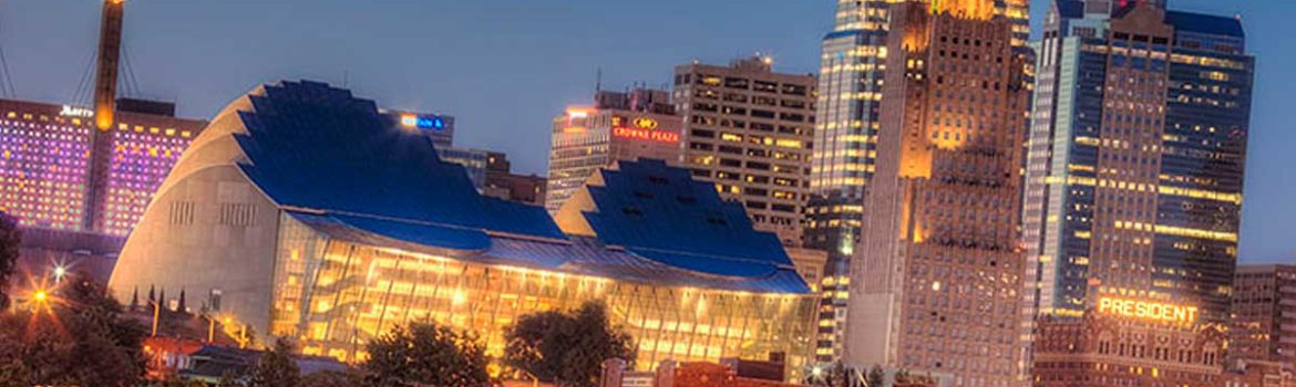 A picture of the Kansas City, MO skyline at night with the Kauffman Center featured..