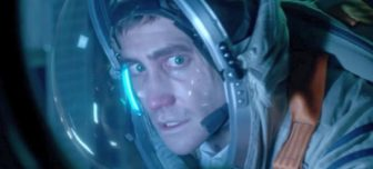 Picture of Jake Gyllenhaal in a space helmet with a frightened look on his face.