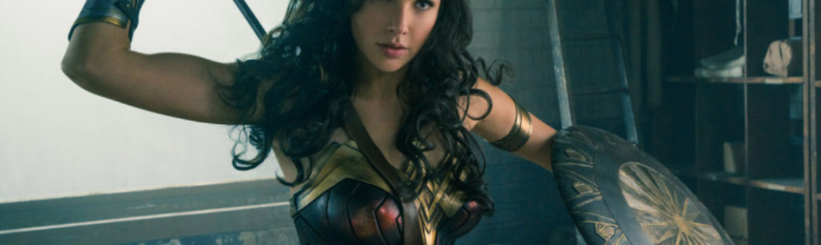 Gal Gadot appears in this shot of Wonder Woman in her warrior uniform carrying a spear and sheild.