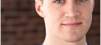 A close up picture of actor, Seth Macchi with