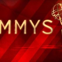 A picture of an Emmy Awards poster with a deep red background and the word