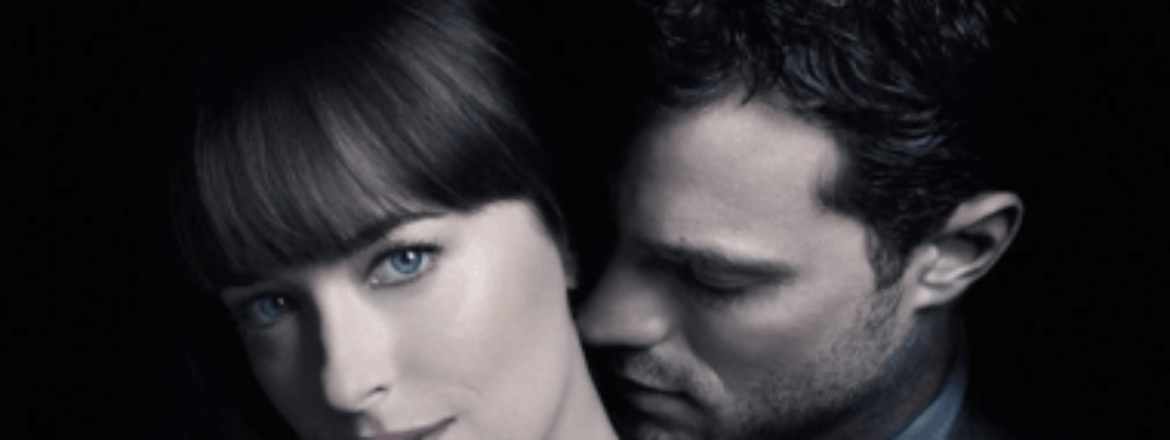 A movie poster of Jamie Dornan and Dakota Johnson in