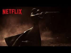 "A poster advertising the show ""Godless"" with a dark brown background and a dark profile of a woman shooting a rifle, her dress trailing behind her in the wind. ""Netflix"" is printed in bold red colors."