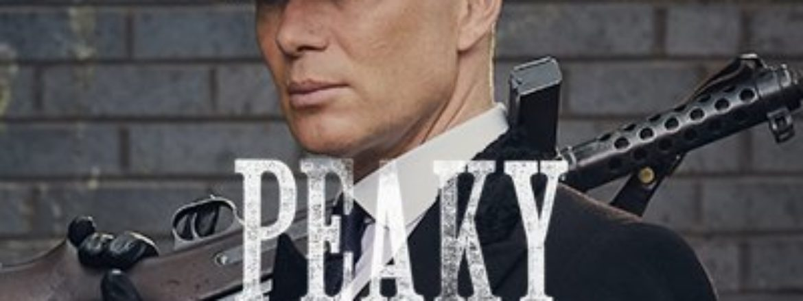 A picture of the lead male character in Peaky Blinders. He's wearing a suit and tie with a grey overcoat and grey cap. He carries a machine gun over his shoulder.