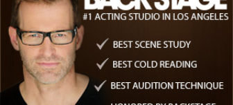 A picture of actor Anthony Meindl in a black v-neck tee-shirt wearing dark reading glasses. The title says,