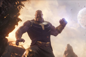 A picture of Thanos preparing to punch someone, fist raised in the air.