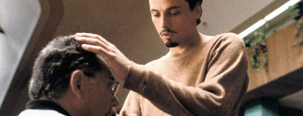 A picture of actor, Skeet Ulrich laying hands on a man to heal him.