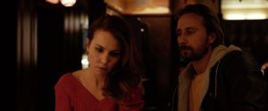 A picture of Noomi Rapace and Matthais Schoenaerts in Marv's Bar.