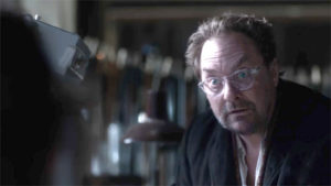"""A picture of actor Stephan Root wearing glasses and looking startled in """"The Man in the High Castle""""."""