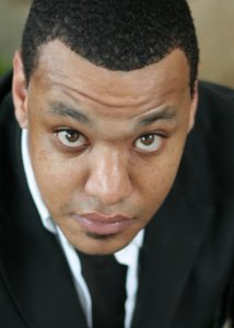 A headshot of actor Keenan Ramos, an African American man.