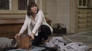 Cate Blanchette kneels on the floor searching through her large purse.