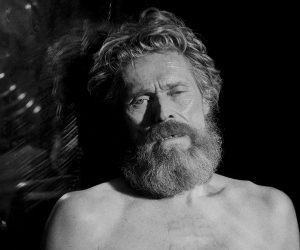 A black and white closeup of a shirtless Willem Defoe.
