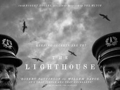 "A black and white poster for ""The Lighthouse"" with Willem Defoe and Robert Pattinson dressed as seamen with a lighthouse in the background."