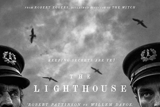 """A black and white poster for """"The Lighthouse"""" with Willem Defoe and Robert Pattinson dressed as seamen with a lighthouse in the background."""